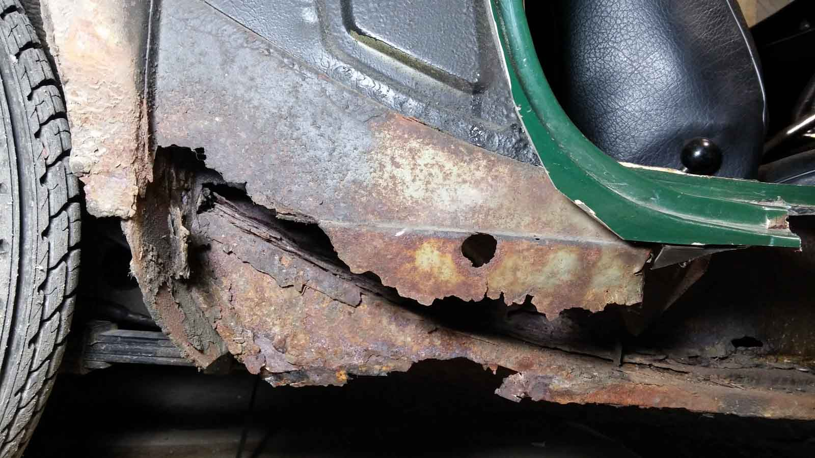 Rusted out dogleg, driver's side