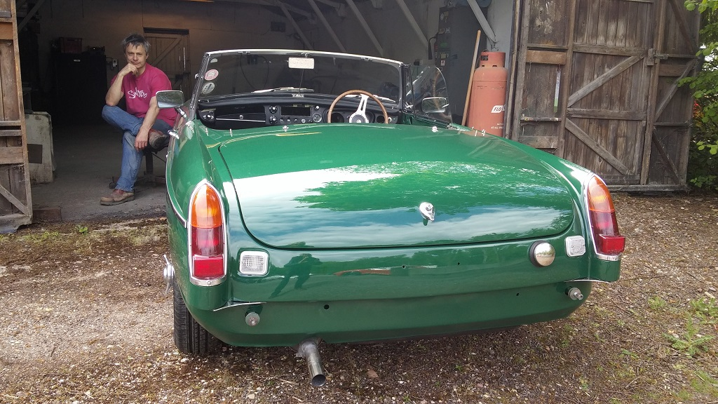 The car emerges from the workshop, on wheels for the first time in eight months